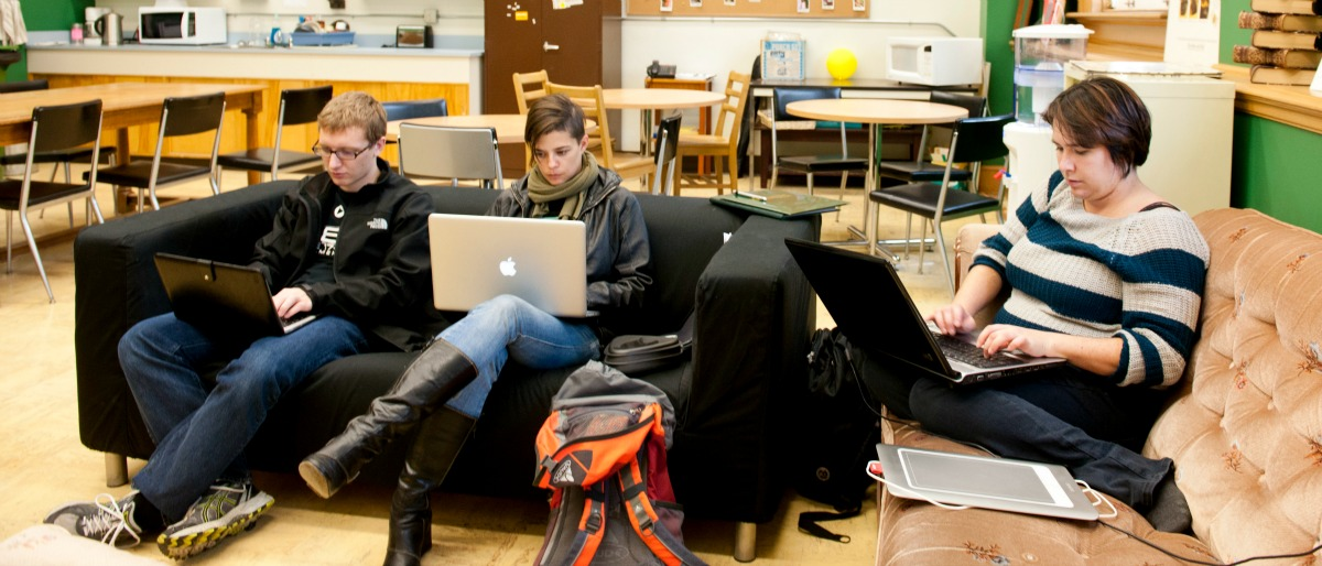 SLIS Students sitting in lounge