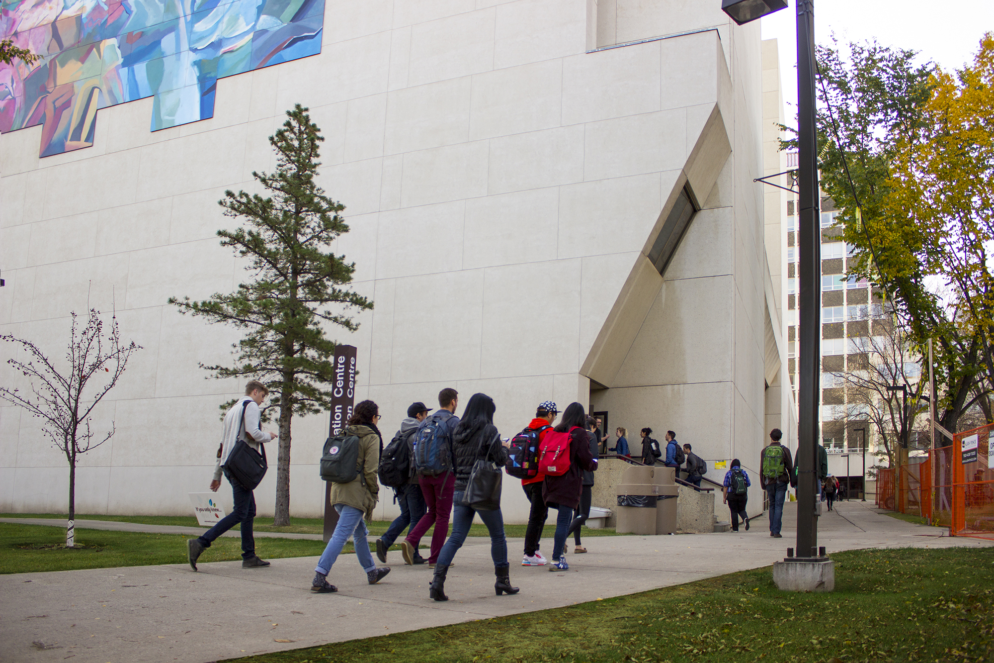 Students walking towards Education North from the northwest
