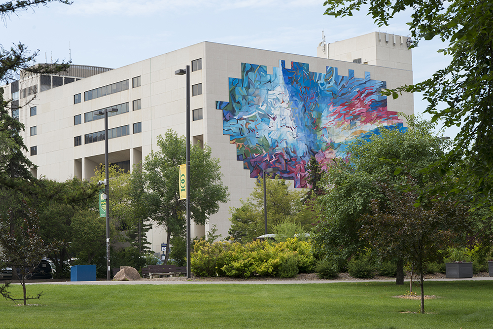 Education North Building in springtime showing mural