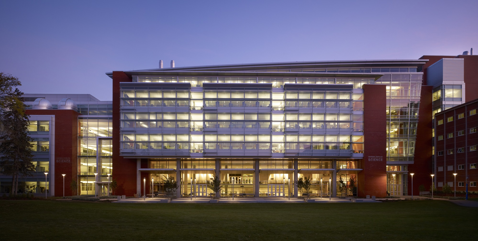 CCIS building lit up at night on the University of Alberta Quad